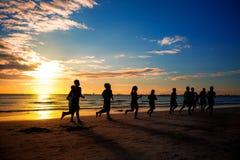 People runs at the beach on beautiful summer Stock Photos