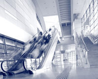People rush on a escalator motion blurred. In Station royalty free stock image