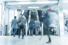 People rush on a escalator motion blurred Royalty Free Stock Images