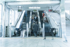 People rush on a escalator motion blurred Stock Photo