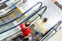 People rush on escalator motion blurred Stock Images