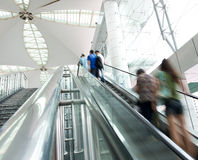 People rush on escalator Royalty Free Stock Images