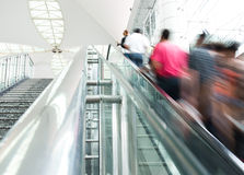 People rush on escalator Royalty Free Stock Photo