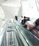 People rush on escalator royalty free stock photography