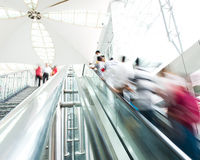 People rush on escalator Stock Photography