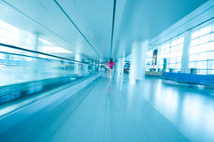 People rush motion blurred in airport Stock Image