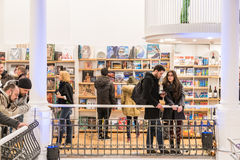 People Rush On Shopping Books In Library. BUCHAREST, ROMANIA - FEBRUARY 12, 2015: People Crowd Rush On Shopping Literature Books In Library Royalty Free Stock Photography