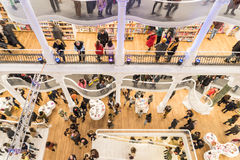 People Rush On Shopping Books In Library. BUCHAREST, ROMANIA - FEBRUARY 12, 2015: People Crowd Rush On Shopping Literature Books In Library Royalty Free Stock Image