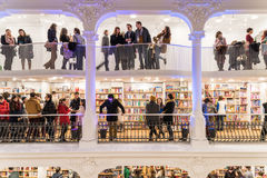 People Rush On Shopping Books In Library. BUCHAREST, ROMANIA - FEBRUARY 12, 2015: People Crowd Rush On Shopping Literature Books In Library Royalty Free Stock Photos