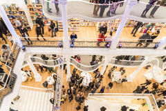 People Rush On Shopping Books In Library. BUCHAREST, ROMANIA - FEBRUARY 12, 2015: People Crowd Rush On Shopping Literature Books In Library Royalty Free Stock Images