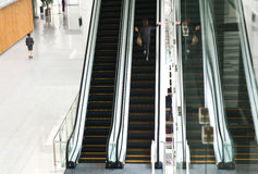 People rushing on escalator Stock Photography