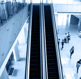 People rushing on escalator Stock Photo