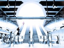 People rushing on the escalator Stock Images