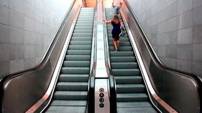People rushing on escalators. Man and woman running and rushing on the escalators video clip stock video