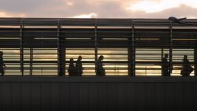 People on an overpass. People rushing at a station stock footage