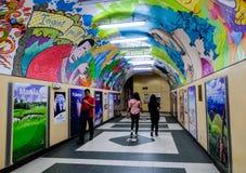 People rushing through a subway corridor Royalty Free Stock Photography