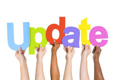People's Arms Raised Holding Word Update Royalty Free Stock Photo
