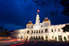 People's Committee building in Saigon, Vietnam. The People's Committee building, also named Hotel de Ville, located in Saigon, Ho Chi Minh city, in dusk Royalty Free Stock Image