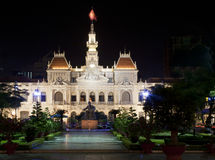 People's Committee Building in Vietnam. The People's Committee Building by night with a statue of Ho Chi Minh in front in Ho Chi Minh City, Vietnam Royalty Free Stock Photo