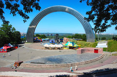 Peoples Friendship Arch in Kiev, Ukraine. Huge, 50 metres in diameter, rainbow-shaped arch made of titanium. Kiev, Ukraine royalty free stock photo
