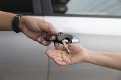 people's hand give and get car key with car background Royalty Free Stock Photography