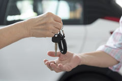 people's hand give and get car key with car background Royalty Free Stock Photos