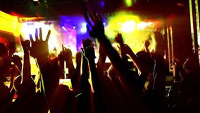 People's hands up on a concert stock video footage