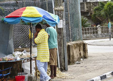 People's Living conditions In Barbados - sidewalk food stand Royalty Free Stock Images