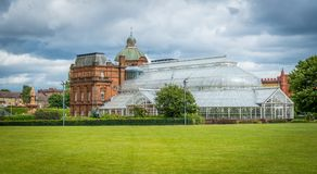 The People`s Palace & Winter Garden in Glasgow, Scotland. Glasgow Green is a park in the east end of Glasgow, Scotland on the north bank of the River Clyde Royalty Free Stock Image