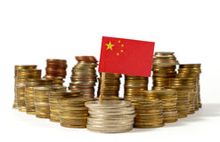 People`s Republic of China flag with stack of money coins Royalty Free Stock Image