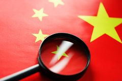The PRC flag is looked through a magnifying glass. Spies and sightings of the People s Republic of China. Monitoring the status of. The People`s Republic of royalty free stock photos