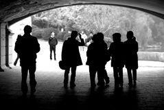 People's silhouette. Silhouette of people under a bridge Stock Image