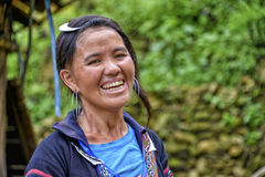 People of Sa Pa in Vietnam. Happy woman of the Black Hmong ethic minority people in the mountains of Sa Pa Royalty Free Stock Photos