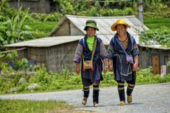 People of Sa Pa in Vietnam. Two smiling and happy women of the Black Hmong ethic minority people walking in the mountains of Sa Pa Royalty Free Stock Image