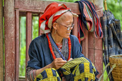People of Sa Pa in Vietnam. Woman of the Red Dao Ethic Minority working and selling goods in the mountains of Sa Pa, Vietnam Royalty Free Stock Photography