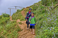 People of Sa Pa in Vietnam. Young girl and old woman of the Black Hmong ethic minority people in Sa Pa Royalty Free Stock Photography