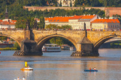 People sail in small boats on the Vltava River, Prague Stock Photography