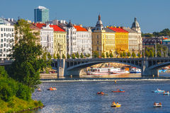 People sail in small boats on the Vltava River, Prague Stock Photo