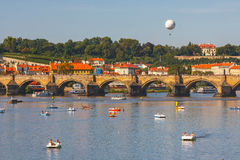 People sail in small boats on the Vltava River, Prague Royalty Free Stock Photo