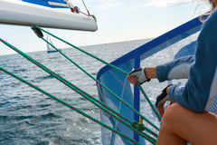 People on sailing boat on the sea Stock Photo