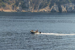 People sailing on motorboat in waters of Tyrrhenian Sea. Elba Island, Italy - June 30, 2015: People sailing on motorboat in waters of Tyrrhenian Sea, region of royalty free stock images