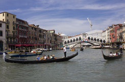 People sailing with Rialto Bridge on the background Royalty Free Stock Photography
