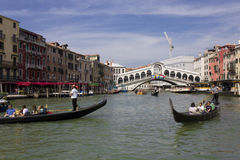 People sailing with Rialto Bridge onthe background Stock Images