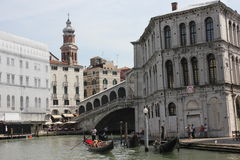 People sailing with Rialto Bridge onthe background Royalty Free Stock Photo