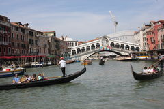 People sailing with Rialto Bridge onthe background Royalty Free Stock Photos