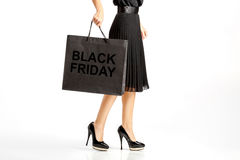 People, sale, black friday concept - woman with shopping bags. People, sale, black Friday and luxury concept - woman in black dress with shopping bags stock photos