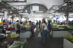 People sale and buy goods and food at local market Stock Photo