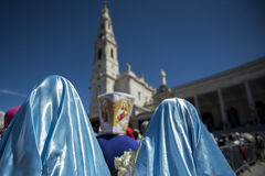 People at the Sanctuary of Fatima during the celebrations of the apparition of the Virgin Mary in Fatima, Portugal. Fatima, Portugal - May 13, 2014: People at Royalty Free Stock Photography