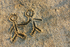 People on sand. Two people on sand holding there hands Stock Image