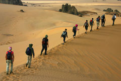 People on the sand dunes Stock Photo